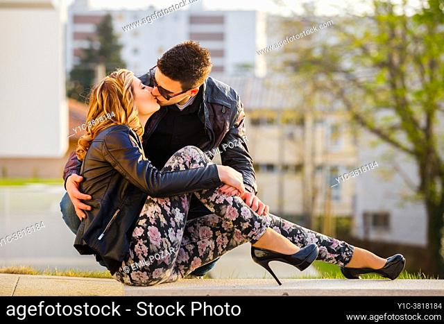 Young couple sunset kiss