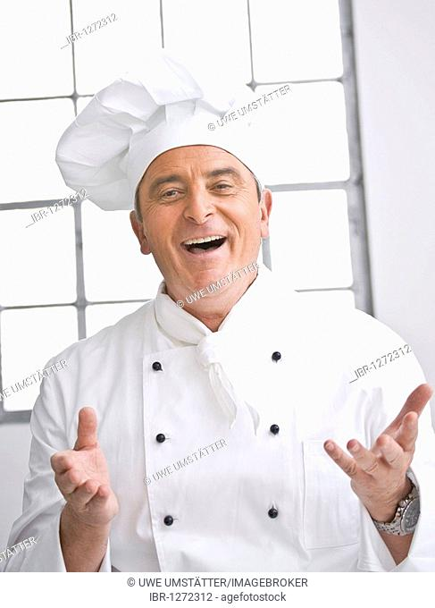 Smiling chef wearing a chef's hat