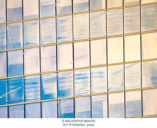 Sunlight reflecting in windows of office building