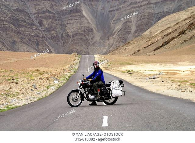 A Tourist is driving Enfield in Himalayas