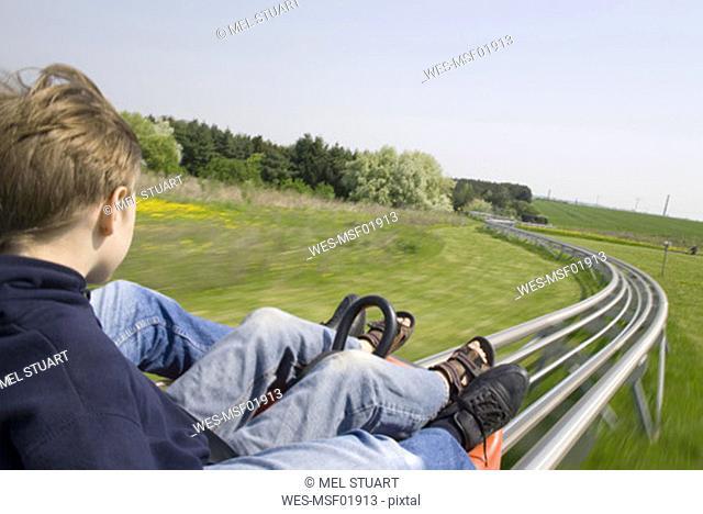 Boys (10-11) in toboggan run, elevated view