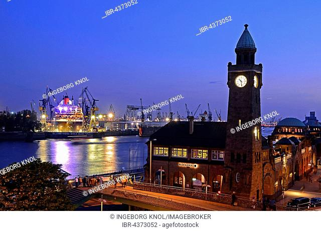 Clock tower overlooking the jetties and dry dock with Queen Mary 2, harbor, Hamburg