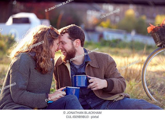 Couple enjoying coffee break on marshes