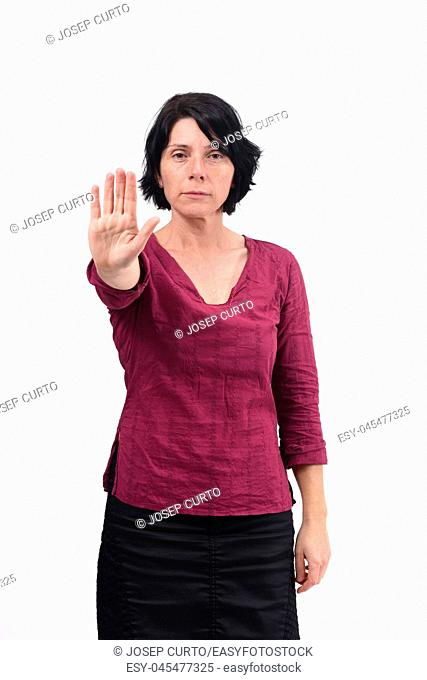 woman with stop sign on white background