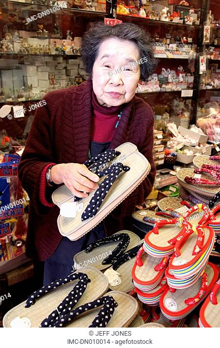 Japan, Hakone, lake Ashi, seller of flip-flop