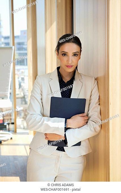 Portrait of businesswoman holding folder
