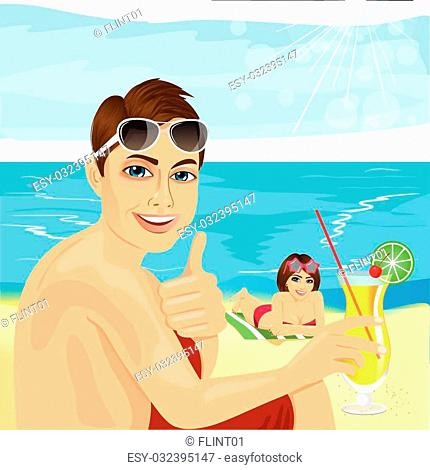 young handsome man with cocktail sitting near his girlfriend lying on towel at the beach