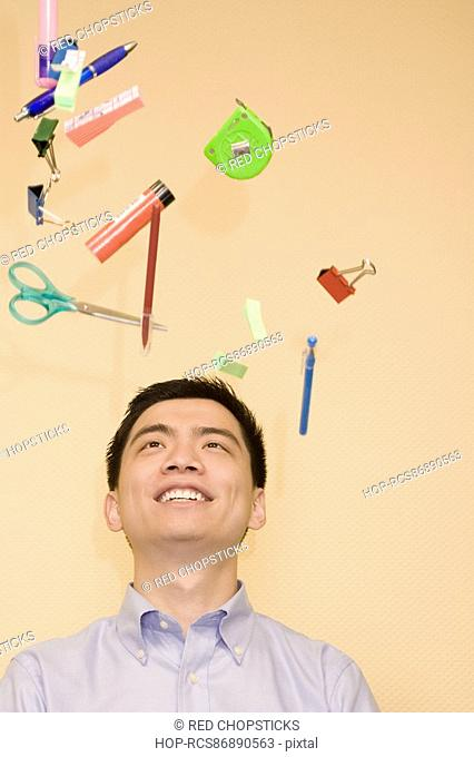 Close-up of a young man looking at stationery objects
