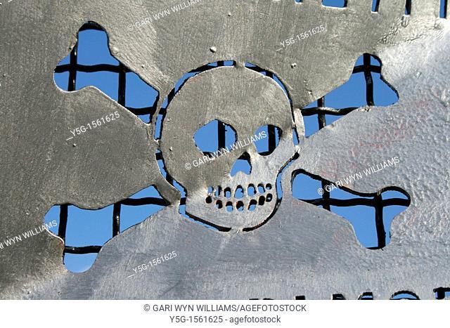 one skull danger high voltage power lines warning