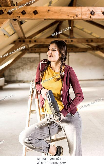 Independent young woman renovating her new home