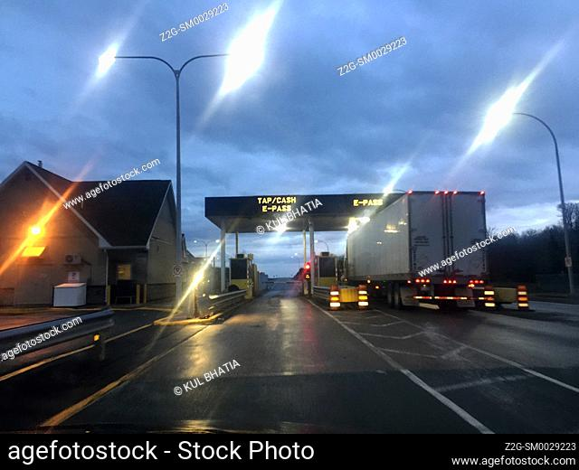 A truck in the E-pass lane of a toll plaza on a modern highway, Nova Scotia, Canada