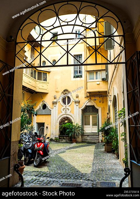 Courtyard of a historic building in rione Regola - Rome, Italy
