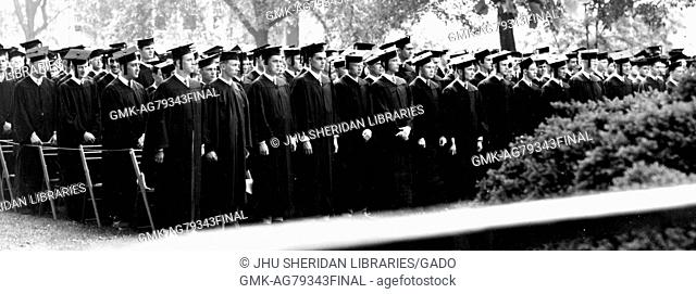 The Johns Hopkins University class of 1947 stands in rows in academic dress during their commencement ceremony on the University's Homewood campus in Baltimore