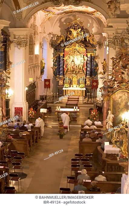 Violau district of Augsburg Swabia Bavaria Germany parish and pilgrimage church S. Michael devotion before the procession with candle lights at the day of the...