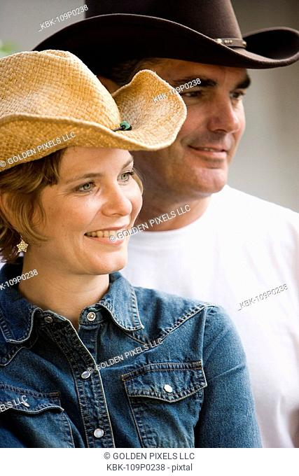 Mature couple in country clothes standing together