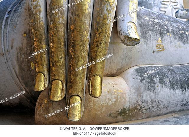 Gold leaf hand of a Buddha statue, Wat Si Chum, Sukhothai Historical Park, Sukhothai, Thailand, Southeast Asia, Asia