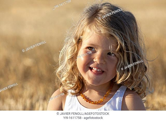 portrait of a girl in the field