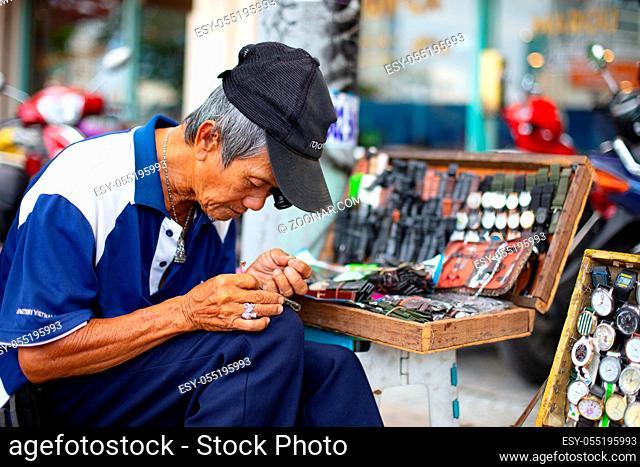 Ho Chi Minh City, Vietnam - September 30, 2018: A man fixes watches on the streets of Ho Chi Minh City, Vietnam