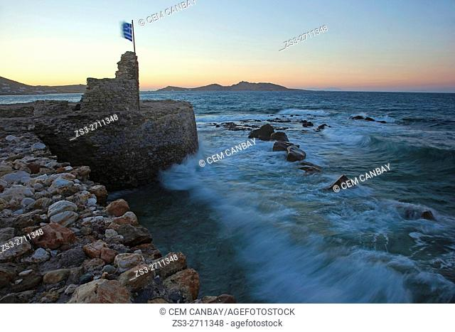 Old castle by the sea at sunset with waves in the foreground, Naoussa, Paros, Cyclades Islands, Greek Islands, Greece, Europe