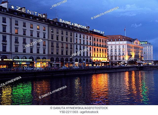 night urban landscape of Geneva, buildings along Rhone river, Geneva, Switzerland