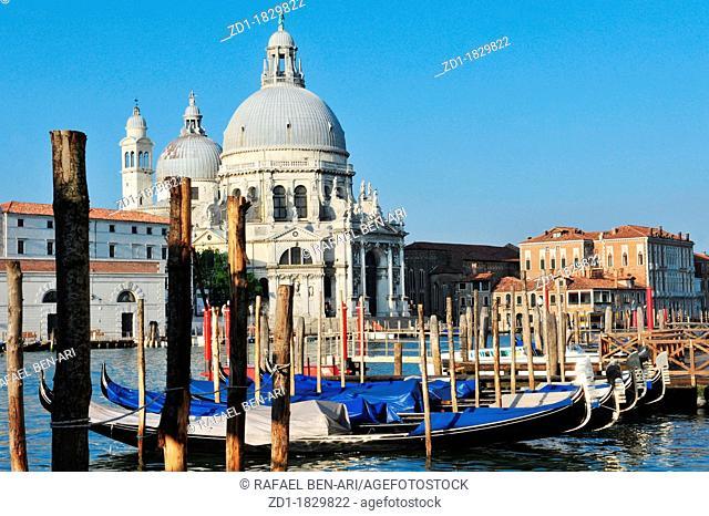 Campo della Salute church with Venetian Gondolas in the foreground