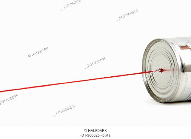 Red string attached to tin can