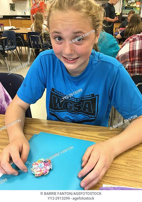 6th Grade Girl Using Fidget Spinner, Wellsville, New York, USA