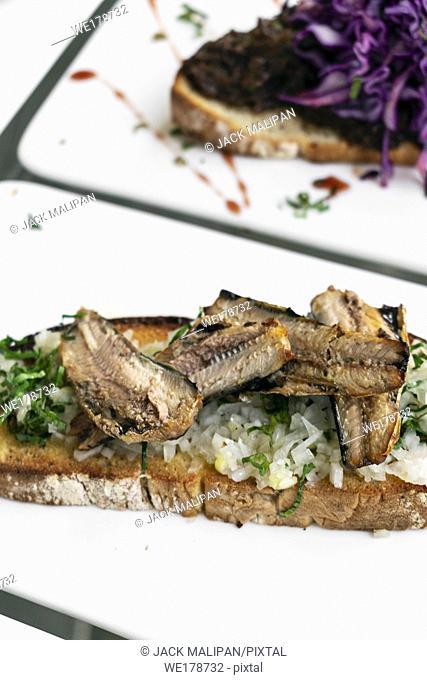 Portuguese tiborna open toast sandwich tapas with sardine and onion garlic snack