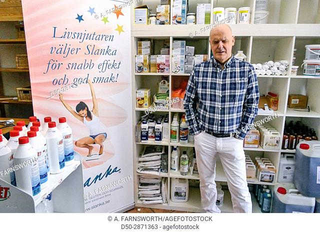 STOCKHOLM, Sweden Blind store owner runs a paint store also selling weight watcher's products
