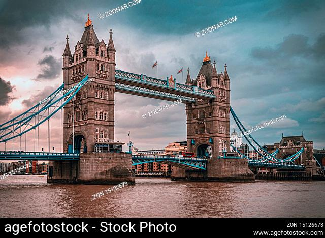 LONDON, ENGLAND, DECEMBER 10th, 2018: Tower Bridge in London at sunrise with beautiful clouds. English symbols