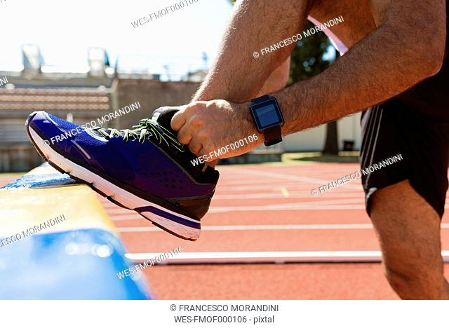 Sportsman, running shoe and smartwatch