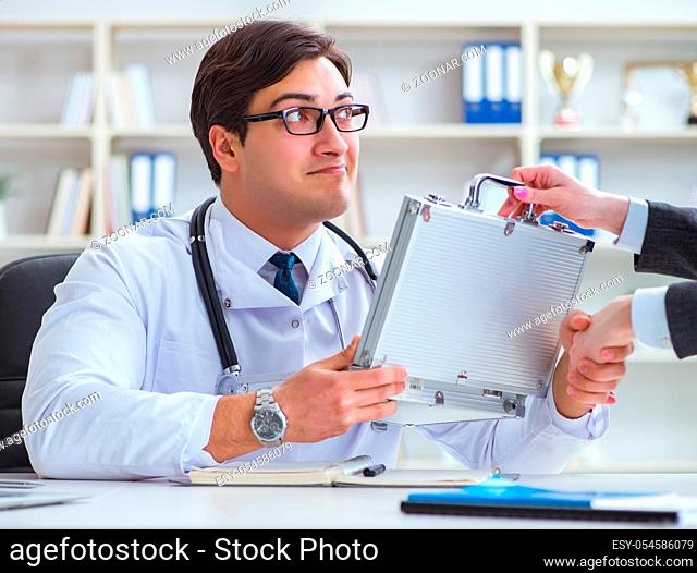 The young doctor in medical insurance fraud concept