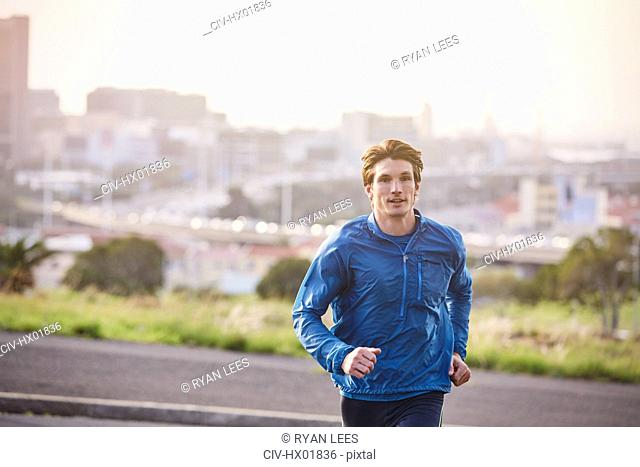 Male runner running on urban city street