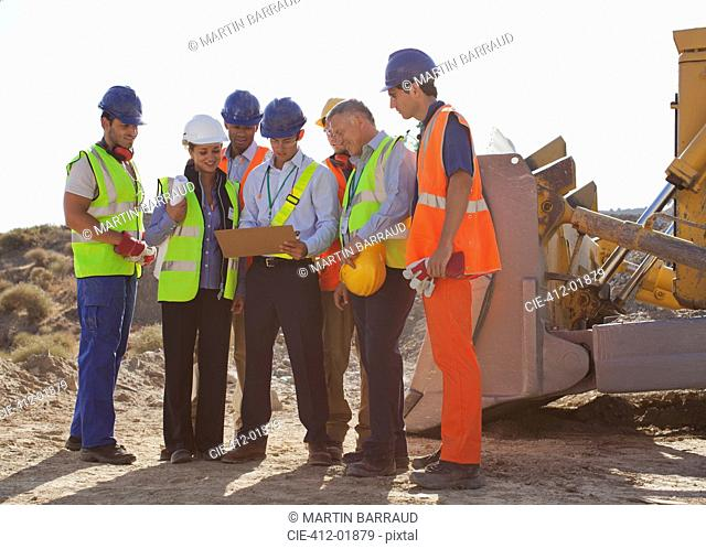 Workers and business people talking on site