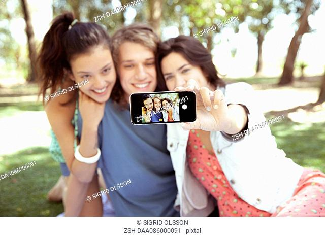 Friends taking selfie together at park