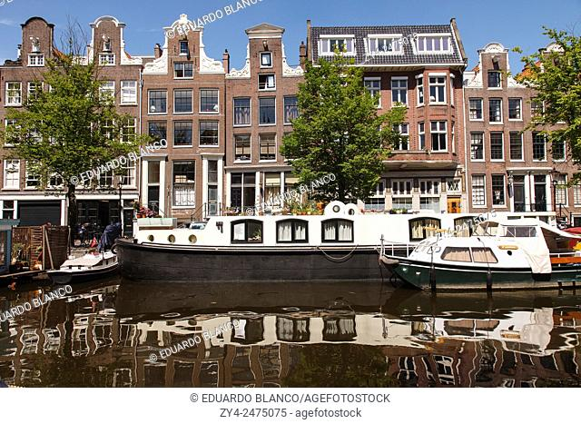 Boats in canal and houses. Amsterdam (Holland)