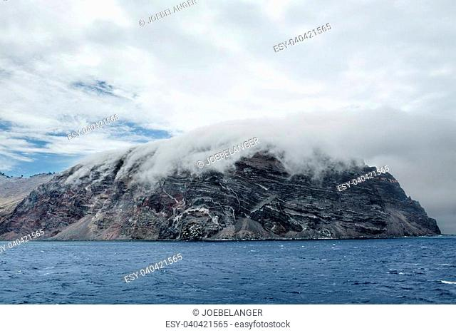 Low clouds hug the remote island of Guadalupe in Mexico