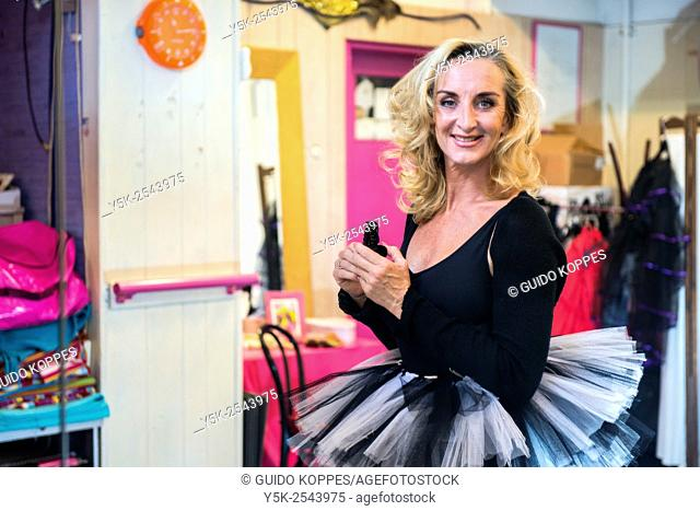 The Hague, Netherlands. 54 year old female teacher of classical ballet and street dance during preparation for a class
