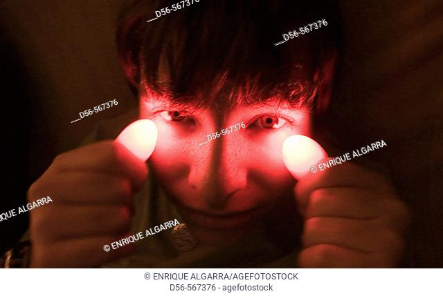Young boy with red light thumbs