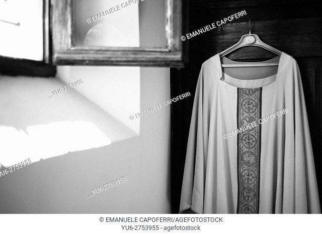 Sacristy, robe of the priest hanging in wardrobe