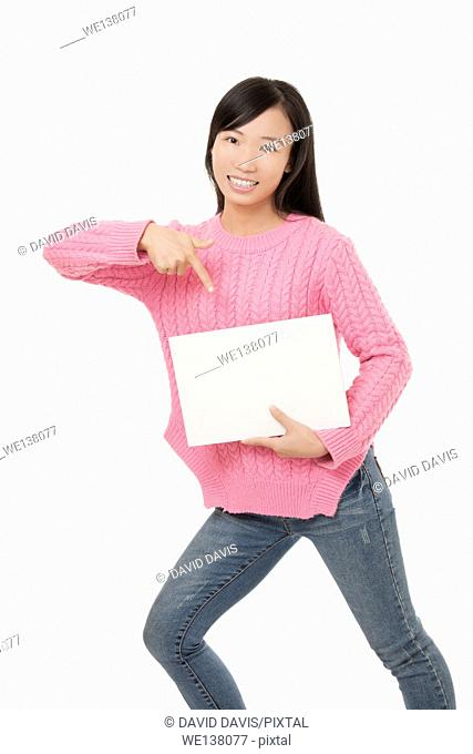 Beautiful Chinese woman holding a blank card isolated on a white background