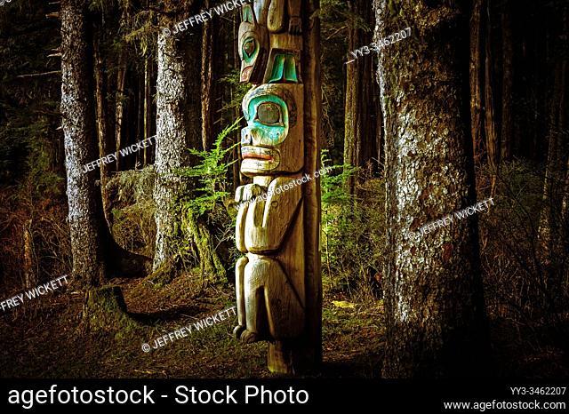 Totem pole beside tourist trail in Sitka National Historical Park in Sitka, Alaska, USA