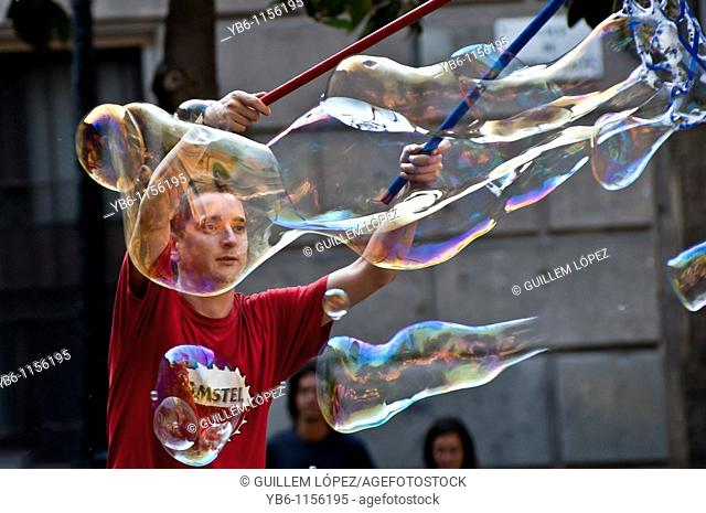 performer blowing giant soap bubbles, Barcelona, Spain
