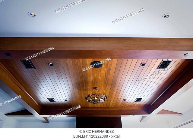 Hanging light on wood paneled ceiling; Newport Beach; California; USA