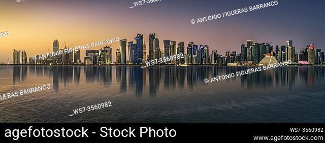 Panoramic view of the Doha skyline at sunset
