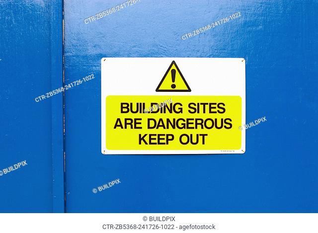 Hoarding with keep out warning sign