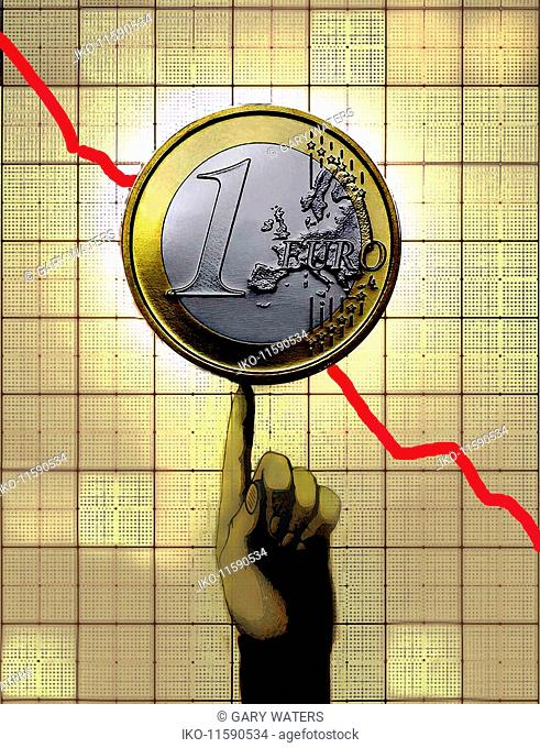 Finger supporting Euro coin on decreasing line graph