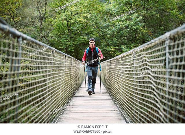 Hiker walking on a bridge in nature