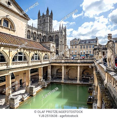 The Roman Baths complex, a site of historical interest in the English city of Bath with the cathedral in the background, Somerset, England