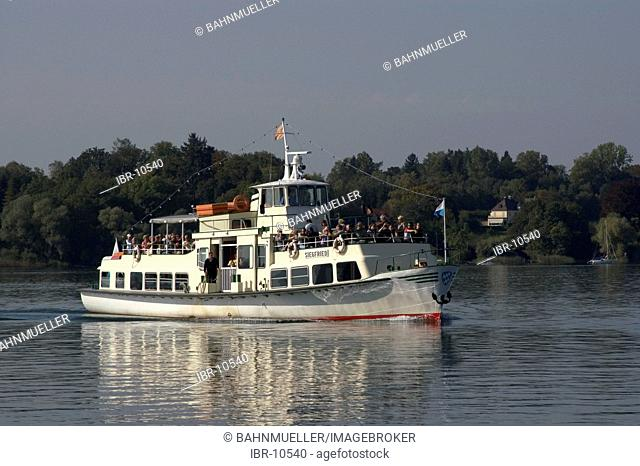 Near Gstadt at the Lake Chiemsee motorboat on the lake Upper Bavaria Chiemgau Germany